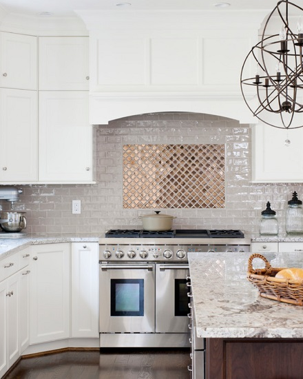 If you don't like the idea of wall-to-wall metallics, metal tile can still make for a great accent, and nicely break up a more traditional arrangement (by WINN Design+Build)