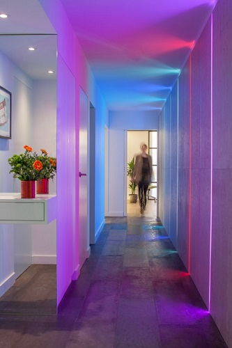 Installing ultraviolet lights might be taking Pantone's color of the year a little too literally, but it's also a great way to get a chic, futuristic look in a modern home (by Cassidy Hughes Interior Design + Styling)