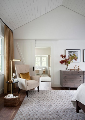 Barn doors offer a beautiful balance of elegance and privacy in a master suite (by Tim Cuppett Architects)