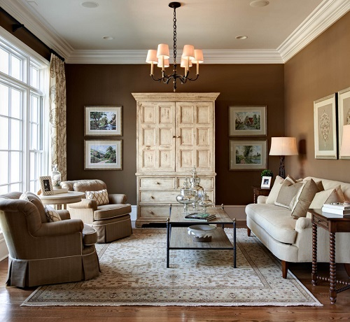 Using darker neutrals doesn't have to mean making a dark room - just one that has a little more weight and texture than one with a white-on-white color scheme (by Carolina Design Associates, LLC)