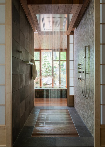 The real advantage of custom showers is that you have total control of the placement, type, and flow of all your shower heads, allowing you to get a truly full-body shower experience (by CTA Architects Engineers)