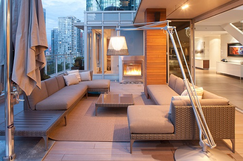 Outdoor Arc Lamps let you get centralized light for your seating set, even if you don't have a covered deck or patio (by Hollam Design)