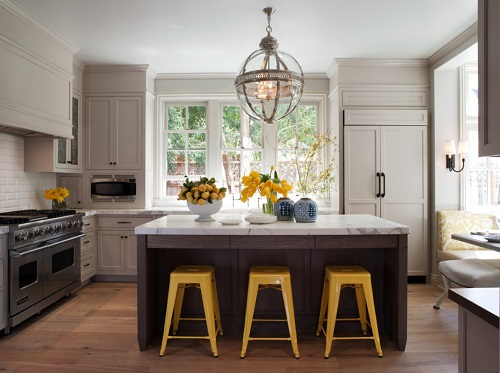 Adding a little pop of color is a great way to spruce up your kitchen - and bar stools are easy to change out if you want to keep up with color trends (by Heydt Designs)