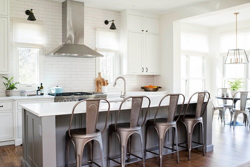 Coordinating your bar stools and dining chairs can help keep an open greatroom feeling unified (by Chelsea Benay, LLC)