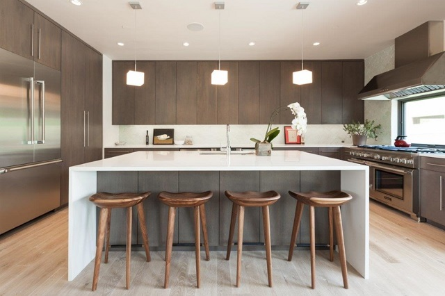 Stylish, distinctive bar chairs can help complete the front-facing look of your kitchen (by New West Building Company)