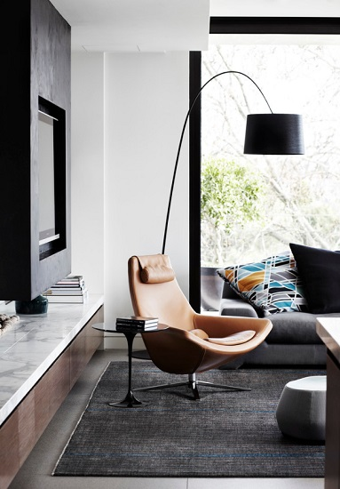 Using a striking midcentury modern accent chair as your reading chair can transform a so-so reading nook into a major feature of your living space (by Christopher Elliott Design)