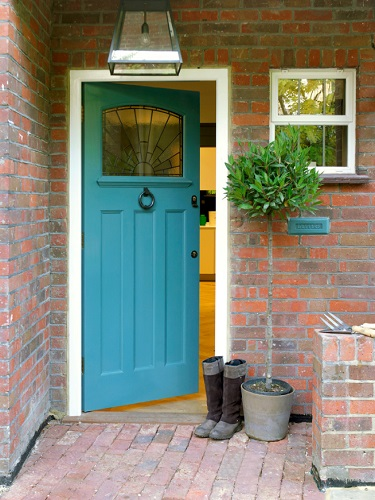 Having a colorful door adds personality to your home's facade and can even improve its curb appeal (by Hannah Brown)