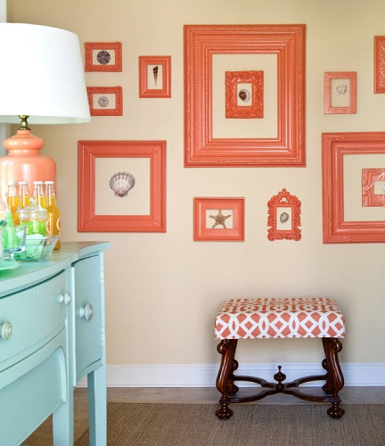 Painting a bunch of frames immediately makes them match, no matter how different they are in size or style (by Tobi Fairley Interior Design)