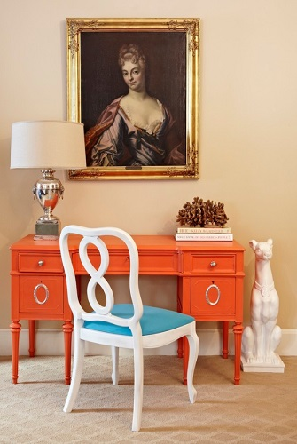 Painting old furniture in a single solid color is a great way to draw attention to the detail work, while covering up any damaged or dated wood (by Jill Sorensen)
