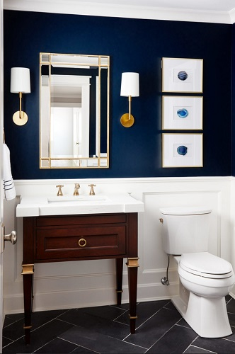 Choosing a bold paint color is the easiest way to add a touch of drama to your guest bathroom, but good accessorizing is key to making this look pop (by Black Knight Group)