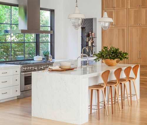 Kitchen island seating is great for getting the family involved in meal prep, but is less conductive to face-to-face interaction (by Coats Homes)