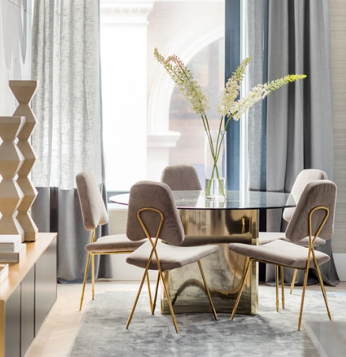 Round tables aren't the best for meals, but they're great for gathering - and an excellent way to make a traditional dining room a little more user-friendly (by Interior Marketing Group)