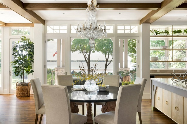 A petite chandelier can help add definition to the dining area of your greatroom, and help it retain some of that formal feel (by Kroiss Development, Inc.)