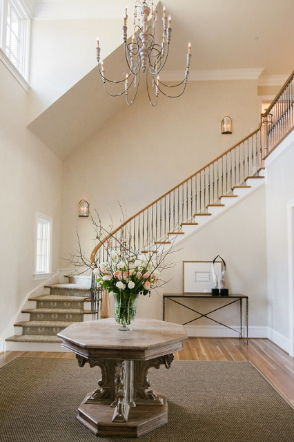 Foyer chandeliers can help make your entryway feel grand, and can help fill that two story ceiling (by JPStyles)