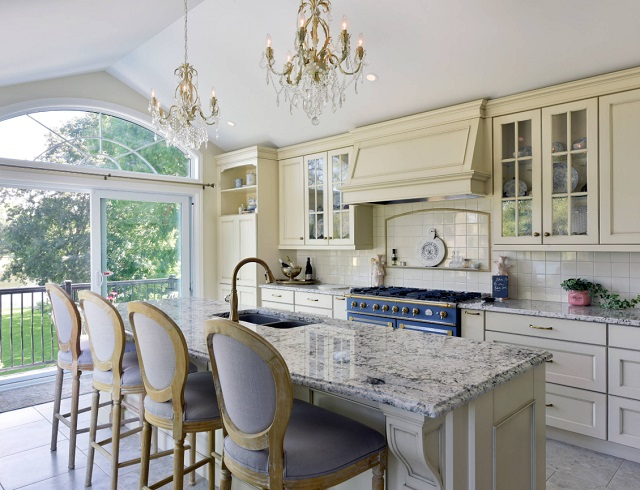 Having crystal chandeliers in your kitchen - even if they're small ones - can help bridge the gap between casual eating and more formal family dining (by Lagois Design Build Renovate)
