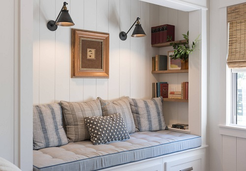 Petite swing arm lights do double duty as spotlight style accent lighting - perfect for highlighting a cozy nook (by Anderson & Rodgers Construction)