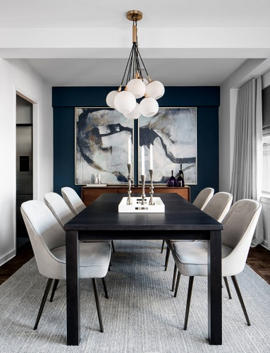 Simple, clean lines and a little touch of contrast give this dining room a refined, sophisticated feel that isn't overly stuffy (by Décor Aid)