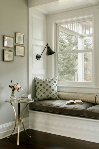 Swing arm lighting fixtures are the perfect finishing touch for a reading nook, since they let you shine light directly on your reading material (by Hudson Home)