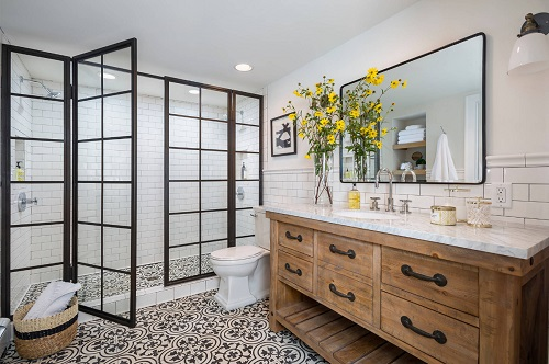 Black-framed shower doors are an unexpected choice that can give your bathroom a stylish touch (by J. Kurtz Design)
