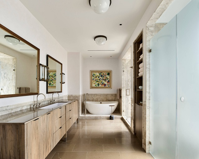 Sacrificing a closet in an adjacent room or hall makes it possible to build a picture-perfect niche for a freestanding bathtub (by Wyant Architecture)