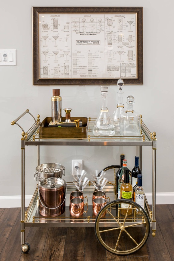 Coordinating your bar cart, accessories, and artwork can create a nicely cohesive look that's simple and relatively affordable to obtain (by Design Shop Interiors)