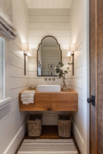 Even starting with the same stylistic elements, you can end up with a very different looking bathroom depending on how you accessorize (by Wright Design)