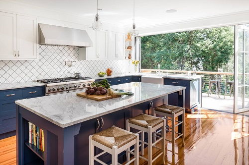 Having fold-away, accordion-style doors and windows lets you fully integrate your kitchen and patio - and even have fun counter-style seating that connects both spaces (by Boston Counters)