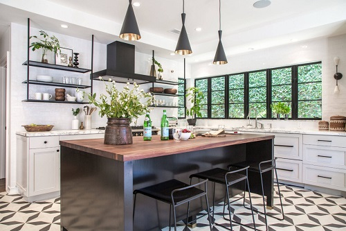 Painting your cabinets black is an easy way to shift the color balance in a white kitchen, but incorporating big and small black accents works great, too (by Cinergy Construction)