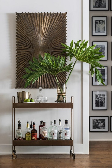 Setting up a bar cart is a snap - just roll it where you want it, lock the wheels, and load it up for an instant decorative element (by John McClain Design)