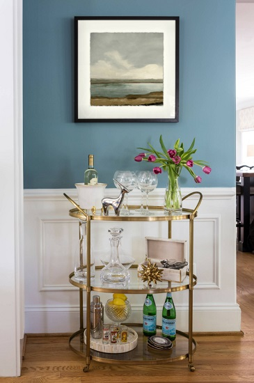 Two of the biggest appeals of bar carts are that they're small enough to be unobtrusive in just about any room, and also portable enough to be moved easily, even when they're full (by Brook Taylor Interiors)