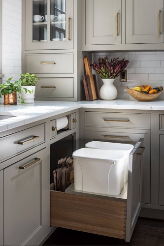 Whether you add a few simple cabinet organizers or totally redesign your cabinetry, better storage will make any size kitchen much more usable (by Studio Dearborn)