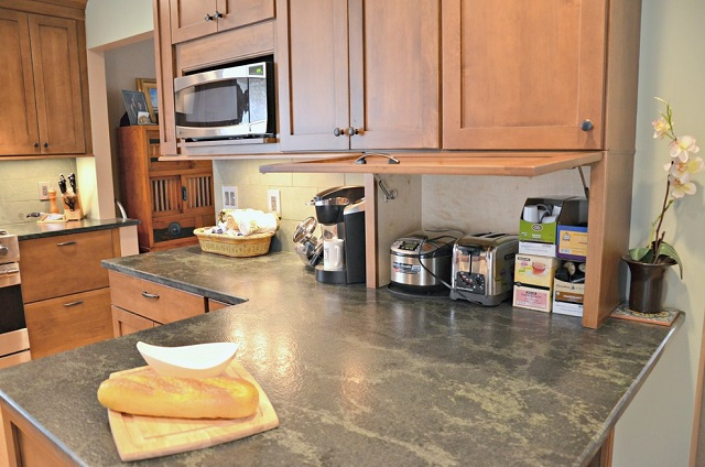 Appliance garages allow you to keep your most-used appliances easily accessible without crowding your counter space (by Harvest House Craftsmen)