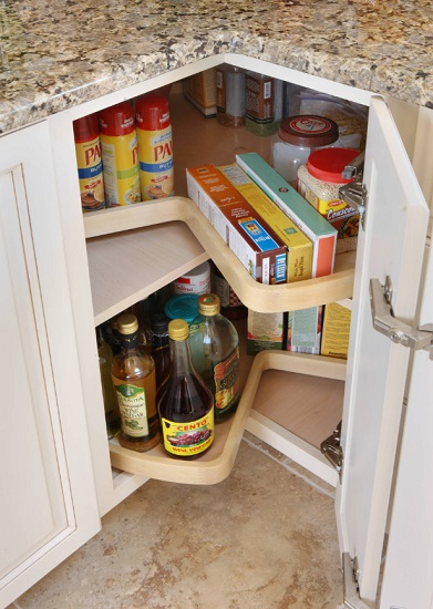 Corner cabinet lazy susans make it possible to maximize the functionality of one of the most awkward cabinets in your kitchen (by Normandy Remodeling)