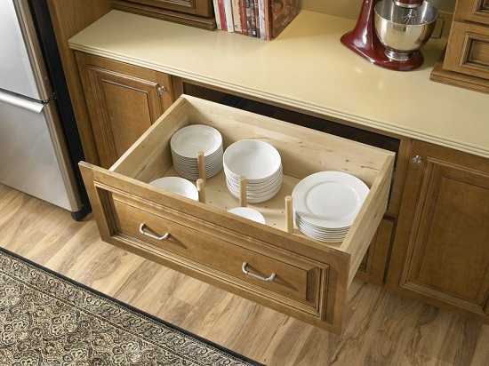 Deep drawers enable you to store large stacks of dishware in a surprisingly compact space (by GR Mitchell Design Center)