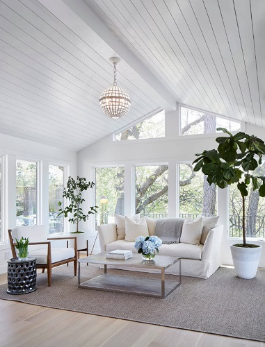 Four-season sunrooms are functionally like a second living room, but typically have a slightly different style than the rest of your house, and larger and more sophisticated windows (by Martha O'Hara Interiors)