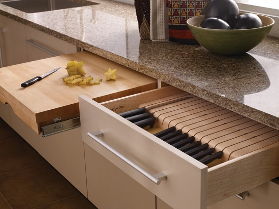 Having specialized knife drawers might seem like wasting drawer space, but it can really help cut down on clutter (by Wood-Mode Fine Custom Cabinetry)
