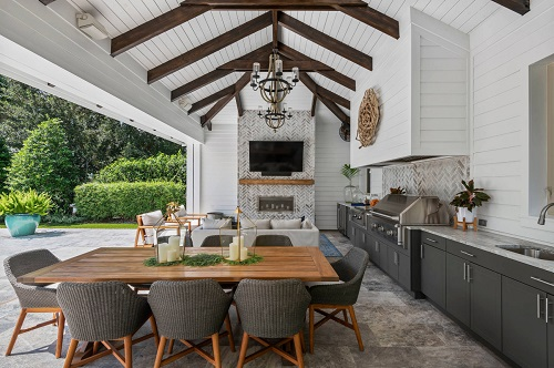 Outdoor kitchens are only covered, not enclosed, but really high end ones come with a whole suite of other ameneties that can help you enjoy your time outside (by E2 Homes)