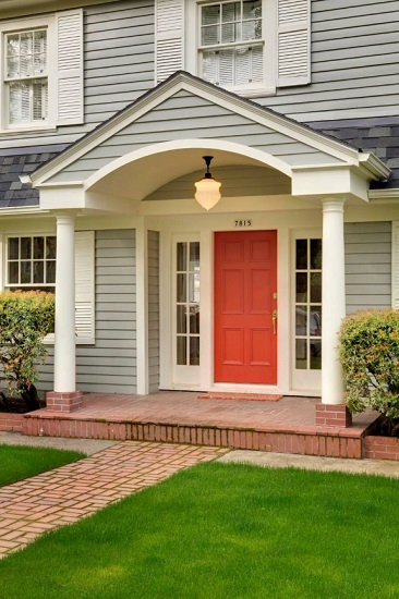 Painting your front door living coral is a simple weekend project that can seriously improve your home's curb appeal (by McCall Design llc)