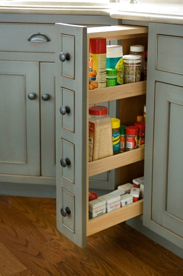Pull out cabinets and pantries come in all shapes and sizes, and are a great solution for awkward spaces that you'd like to put to better use (by Heartwood Kitchens)