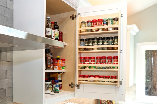 Simple spice racks are easy to install, but look lovely and will really help get your spice cabinet organized (by Beyond the Box - Kitchen Design)