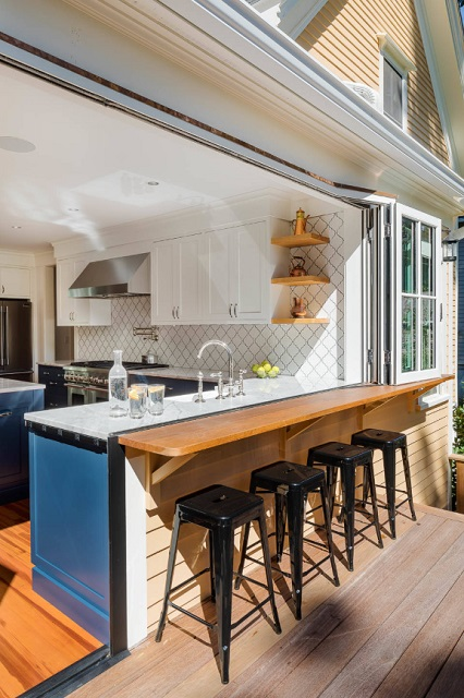 Whether it's a full accordion wall or a peek-a-boo, drive-thru style window, connecting your kitchen to your outdoor spaces is a great way to facilitate summer entertaining (by Boston Counters)