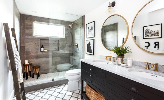 Wood print tile and gold hardware aren't traditional choices for a farmhouse bathroom, but they help recreate the atmosphere of a rustic farmhouse setting (by Juxtaposed Interiors)