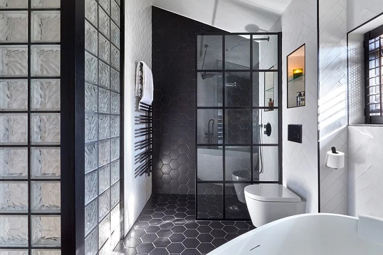 Even in a single solid color with relatively minimal grout, hexagonal tile has a unique and eye catching shape that's perfect for making a statement (by Claudia Dorsch Interior Design)
