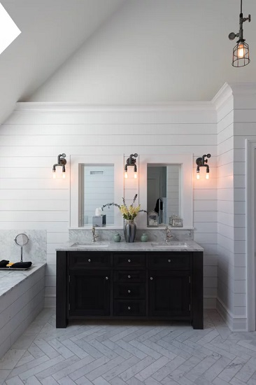 Dark colors and industrial-style vintage fixtures help give a farmhouse bathroom a slightly more urban feel (by Olson Development LLC)