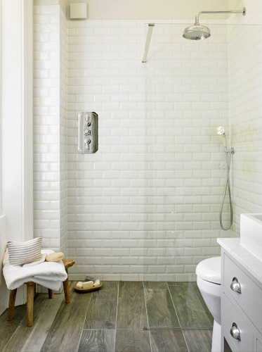 Having your bathroom and shower floors made seamlessly out of the same material can be tricky to pull off, but looks spectacular (by LEIVARS)