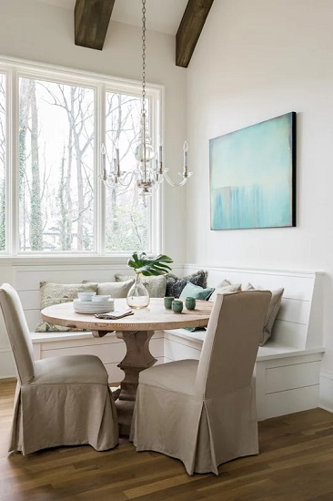 High backed dining chairs with slipcovers are the perfect midpoint between traditional seating and homey comfort (by New Rosslyn Construction)