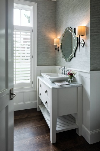 In a bathroom no one is using to get ready in the morning, choosing a statement mirror instead of something a little more practical can be a great way to make a statement (by Swan Architecture)