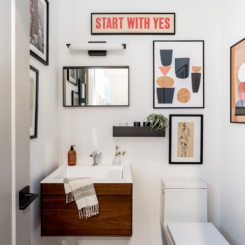 In a low-traffic bathroom where you don't have to worry about damage from water or steam, you have a lot more freedom to decorate with fine art (photo by Jess Blackwell)