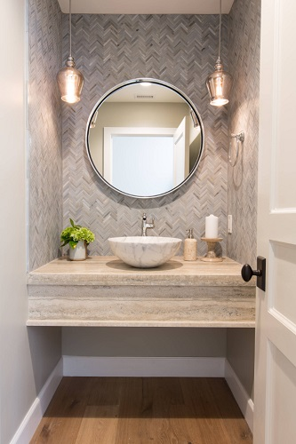 Natural stone makes for a fantastic, eye-catching accent, whether it's stone mosaic tile, a solid slab for your vanity or backsplash, or even a stone vessel sink (by Denise Morrison Interiors)