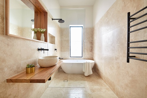 Seamless shower floors and frameless shower panels or splash guards make for an almost invisible shower enclosure - and an incredibly open-feeling bathroom (by smarterBATHROOMS+)